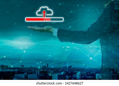 smart city and cloud network, businesswoman holding icon upload into system big data, with internet of things technology, background cityscape, concept data processing and storage