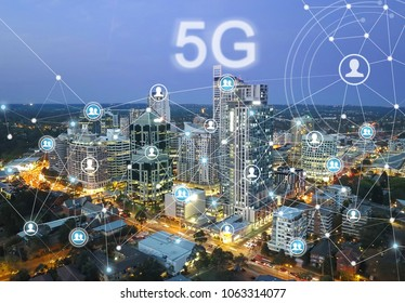 Smart city and communication network concept. 5G network wireless systems and internet of things with modern city