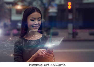 Smart city data concept. A beautiful young Asian woman is connected to a public digital network through her nod, mirrored as an augmented reality projection emerging from her phone.