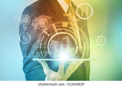 smart city and modern lifestyle concept, a man holding a tablet pc