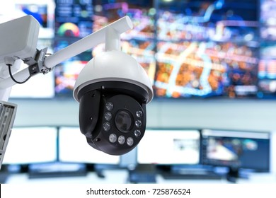 Smart city technology concept. Security camera for monitoring everything in city with control monitoring room background.