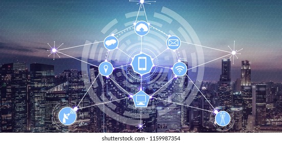 Smart city wireless communication network with graphic showing concept of internet of things (IOT) and information communication technology (ICT) against modern city buildings in the background.