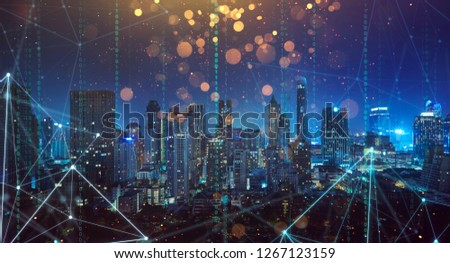 Smart city with wireless network and 5g connection technology . Bangkok city background at night .
