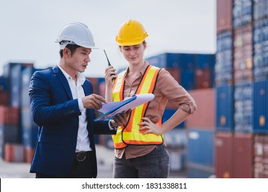 Smart creative foreman and engineer woman control loading containers box from cargo freight ship for import export. Logistic, transportation, import and export concept. With copy space.