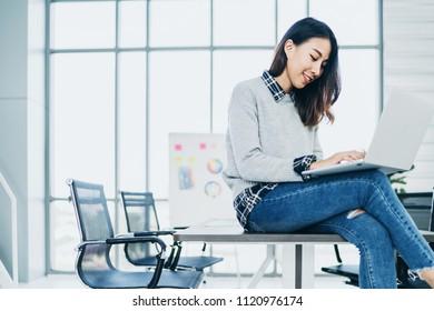 smart creativity asian woman designer work at office background