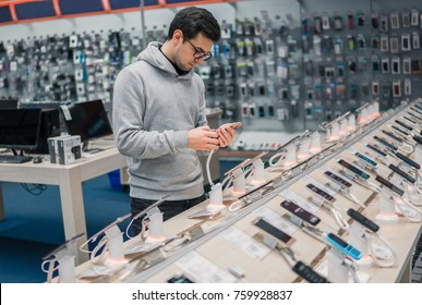 Smart customer choosing smartphone in the mobile phone shop. difficult decision. Various choice.