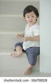 Smart and cute Asian boy take relax at home, Thailand.