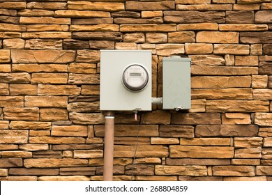 Smart Electric Utility Meter mounted on Natural Stone Wall.