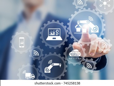 Smart factory automation and industry 4.0 concept with connected production robots data with internet of things (IoT) and cloud computing technology, businessman touching interface with icons in gears