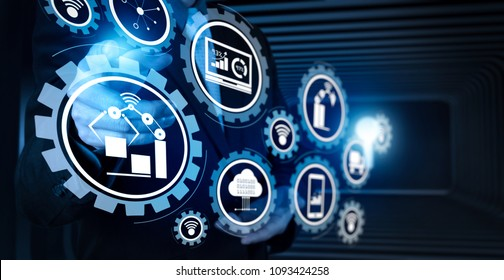Smart factory and industry 4.0 and connected production robots exchanging data with internet of things (IoT) with cloud computing technology.Businessman hand pressing an imaginary button.