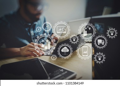 Smart factory and industry 4.0 and connected production robots exchanging data with internet of things (IoT) with cloud computing technology.Co working process, entrepreneur team working