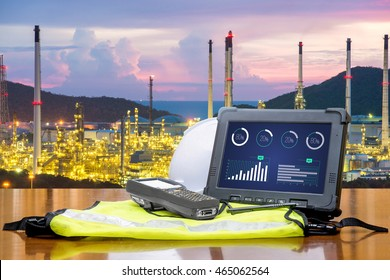 Smart factory - Rugged computers tablet in front of oil refinery industry.