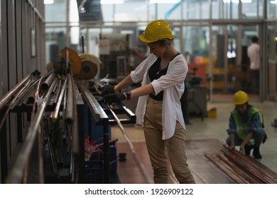 Smart factory women concept. Inspection technician, factory engineer, inspection of the machine condition in the factory. Inspection by technicians, industrial business, production machinery