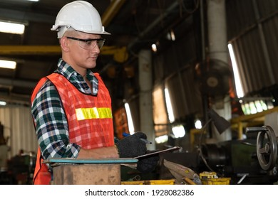 Smart factory worker or engineer do machine job in a manufacturing workshop . Industry and engineering concept .