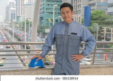 Smart foreman standing with in modern city.