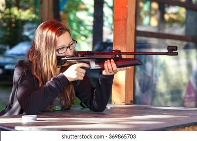 Smart girl shooting from air gun