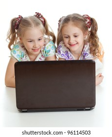 smart girlfriends smiling and looking at the laptop