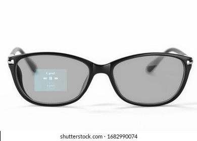 Smart glasses with music player app on white background. Innovative gadget with holographic lenses.