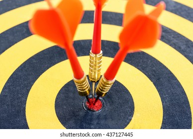 Smart goal setting, Close up one target with three dart arrows hitting on the center of bullseye.