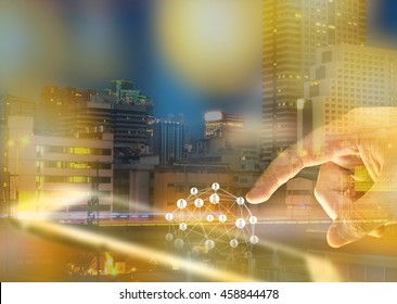 Smart grid and energyconcept , Electric Energy Distribution Chain concept , Blur Power grid network symbol and smartphone and finger with abstract Metropolis building for background