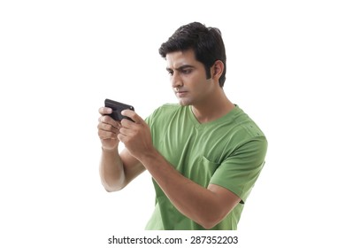 Smart guy reading text message over white background