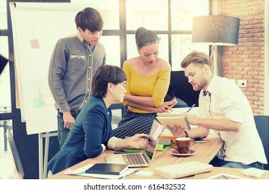 Smart handsome european man business officer explaining internal meeting to his project team in modern office. the multi ethnic business person group in casual suit. Project and Business concept.