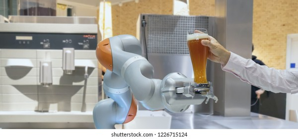 smart handy dexterous chef robotic assistant in kitchen technology concept, robot hand receive an order and serve, mixing the beer or drinking water, juice  for customer or owner