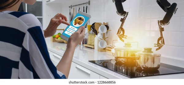 smart handy dexterous chef robotic assistant in kitchen technology concept, robot hand receive an order and cooking the recipe by program and it use self-teaching technology for update the new menu