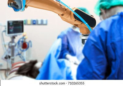 Smart healthcare technology , artificial intelligence concept. Selective focus on automation robot hand machine in operating room and surgery doctors in hospital.