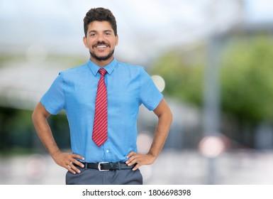 Smart hispanic businessmann with beard and tie