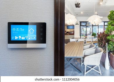smart home app in control panel in modern restaurant