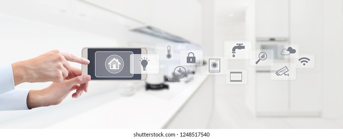 smart home automation control concept hand touch cell phone screen with grey symbols icons on kitchen background web banner and copy space template