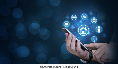 Smart home concept. Mobile phone with the smart home app with modern life.