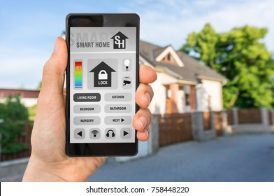 Smart home control app on smartphone with unfocused home in background