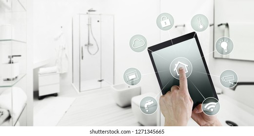 smart home control concept hand touch digital tablet screen with icons, isolated on blurred bathroom background, web banner and copy space template