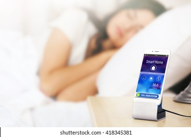 Smart home control concept. Smart phone near bed