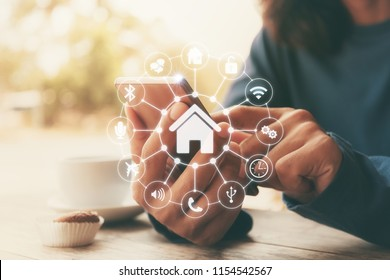 Smart home control with Smartphone,Lifestyle of person in modern life internet of things, Smart house technology.The new innovation of the Future.