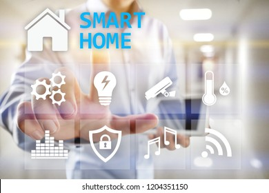 Smart home digital interface on virtual screen. Internet and automation technology concept.