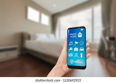 Smart home, intelligent house automation remote control blur of bedroom background smart home control concept