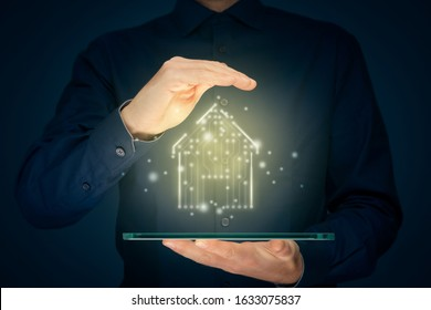 Smart home, intelligent house, and home automation app security concept. Smart house icon with pcb design, tablet and businessman with protective insurance gesture.