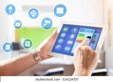 Smart home, intelligent house automation remote control technology concept on smart phone / tablet working with smarthome app