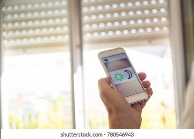 Smart Home: Man Controlling Blinds With His Phone