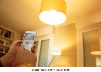 Smart Home: Man Controlling Lights With His Phone