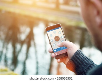smart house device illustration with app icons. Man in the nature holding his smartphone with smart home app