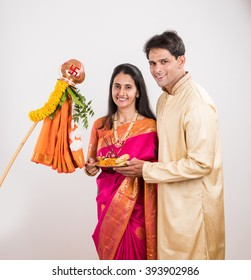 4eebb02570 Smart Indian young couple performing Gudi Padwa Puja in traditional cloths  & pooja thali. It's