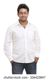 Smart Indian young man posing with expression on white background.