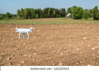 Smart innovations agriculture. Using drone with high resolution digital camera on field with a lot of stones. Modern Agro manufacturing concept.