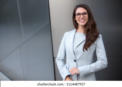 Smart intelligent business woman portrait in glasses, ceo, owner, industry leader, global executive