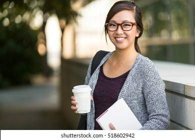 Smart intelligent grad student glasses confident happy at university hall walking to class