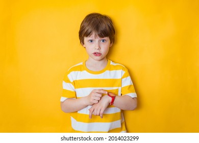 Smart kid boy pupil shows the time on his watch, back to school. Education concept, time management
